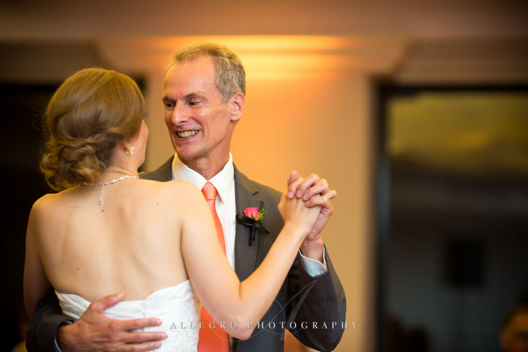 father of the bride smiles as they share their dance