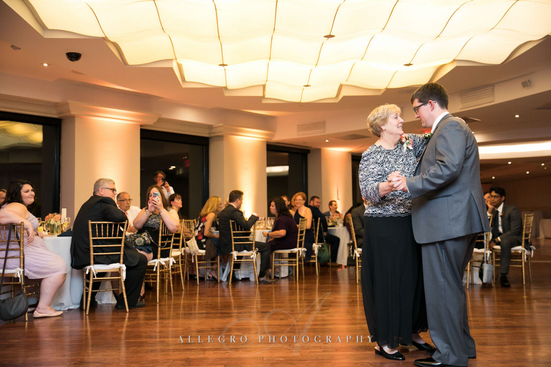 mother of the groom and groom dance together