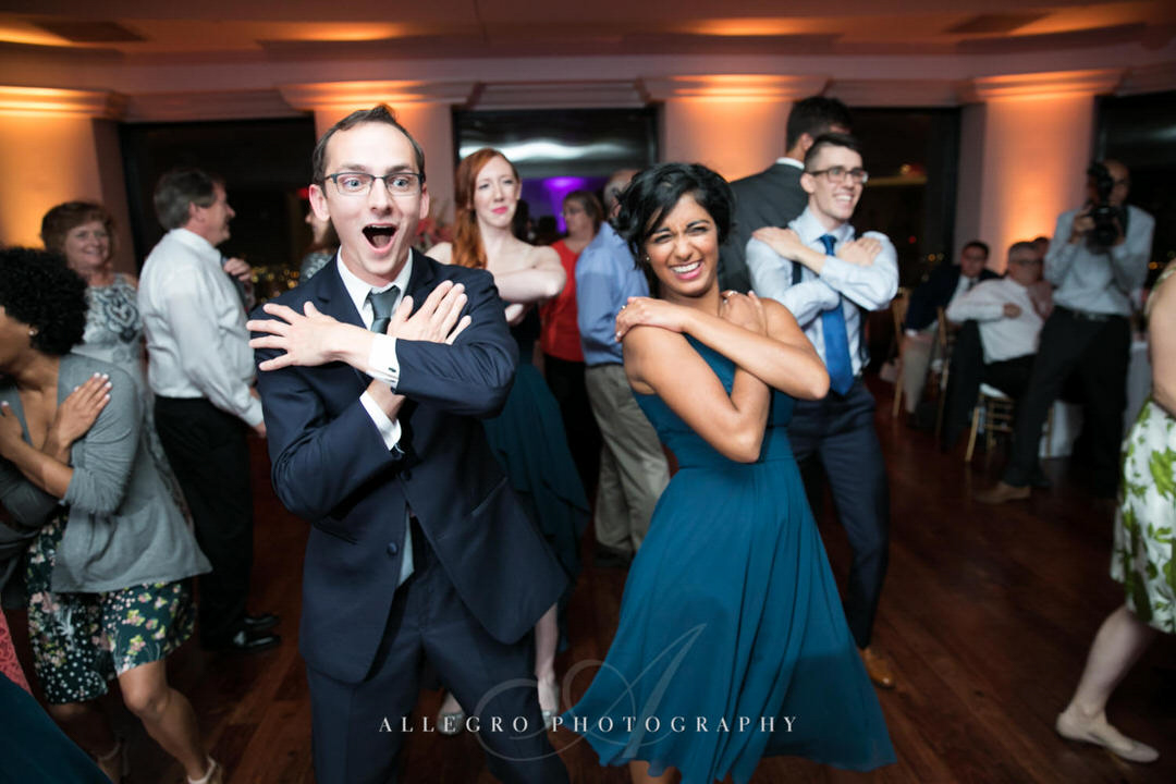 groomsman and bridesmaid have fun dancing