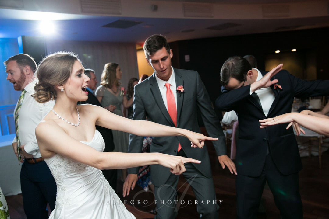 bride and groomsman dancing