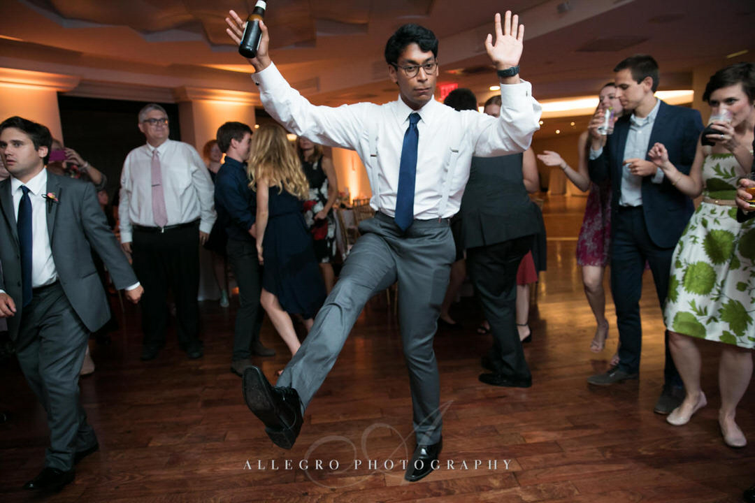 groomsman dances in the center of the dance floor