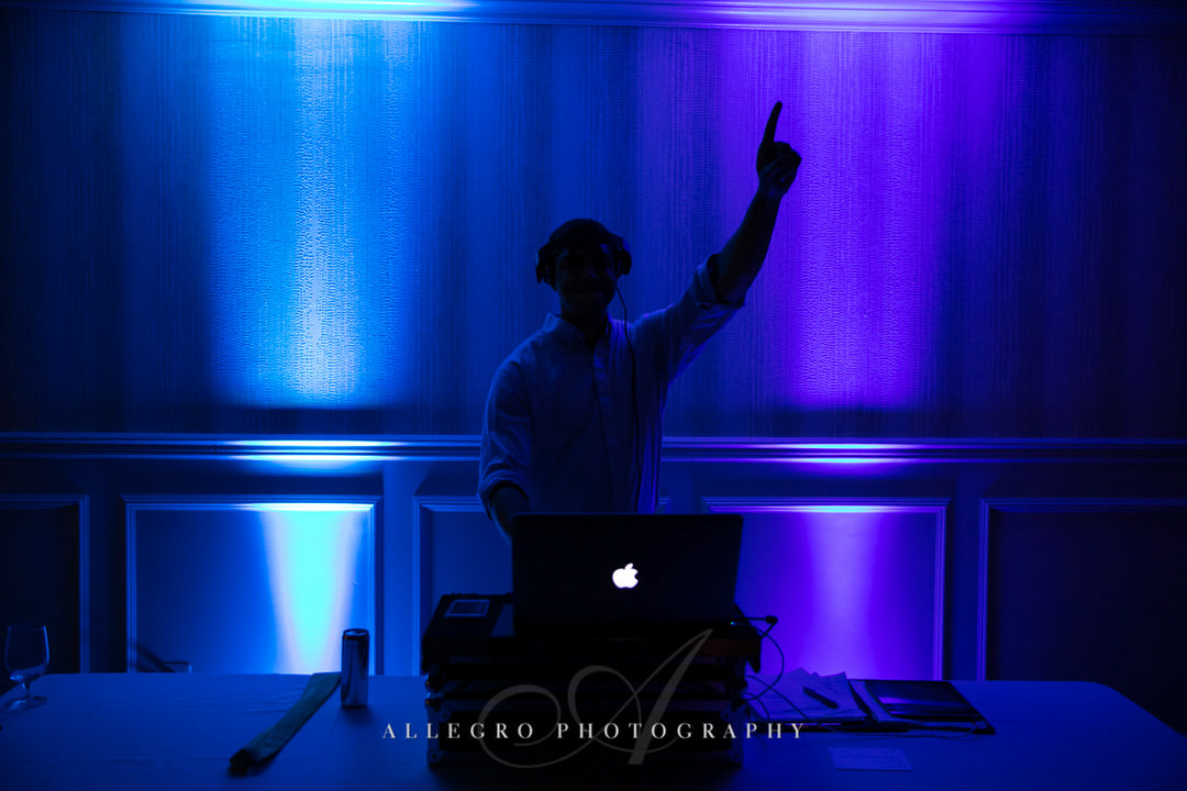 Dj with blue and purple lights