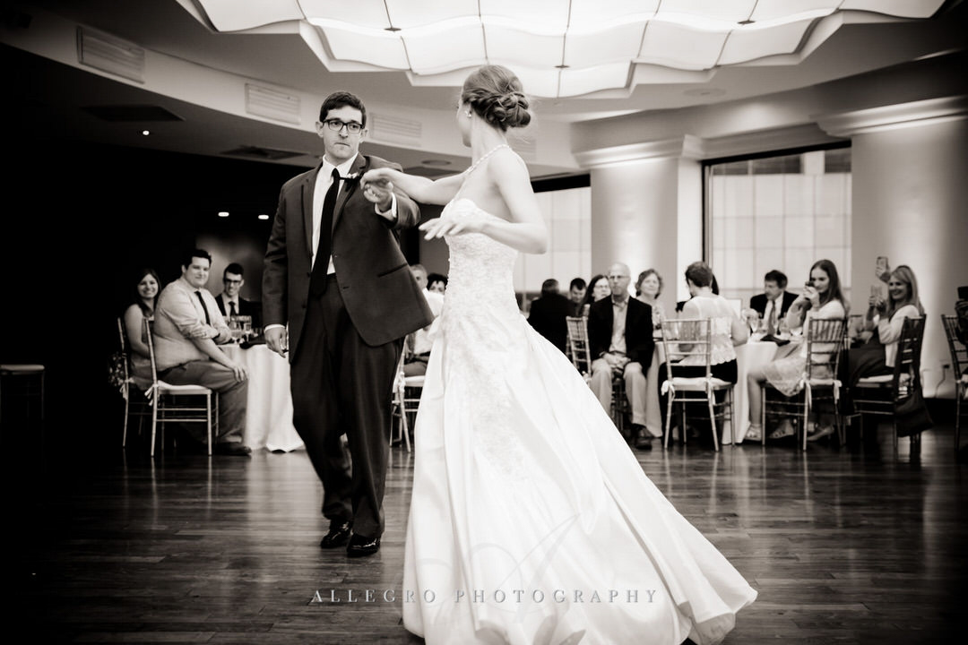 groom spins bride during their first dance