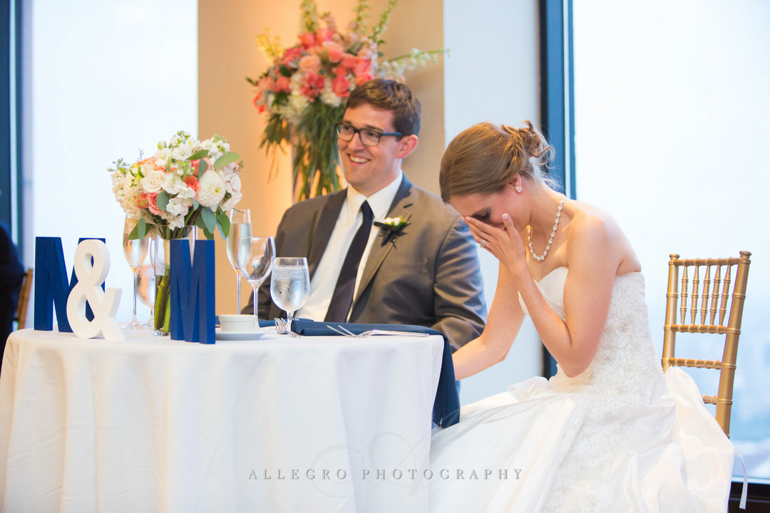 bride laughs while father of the bride makes toast