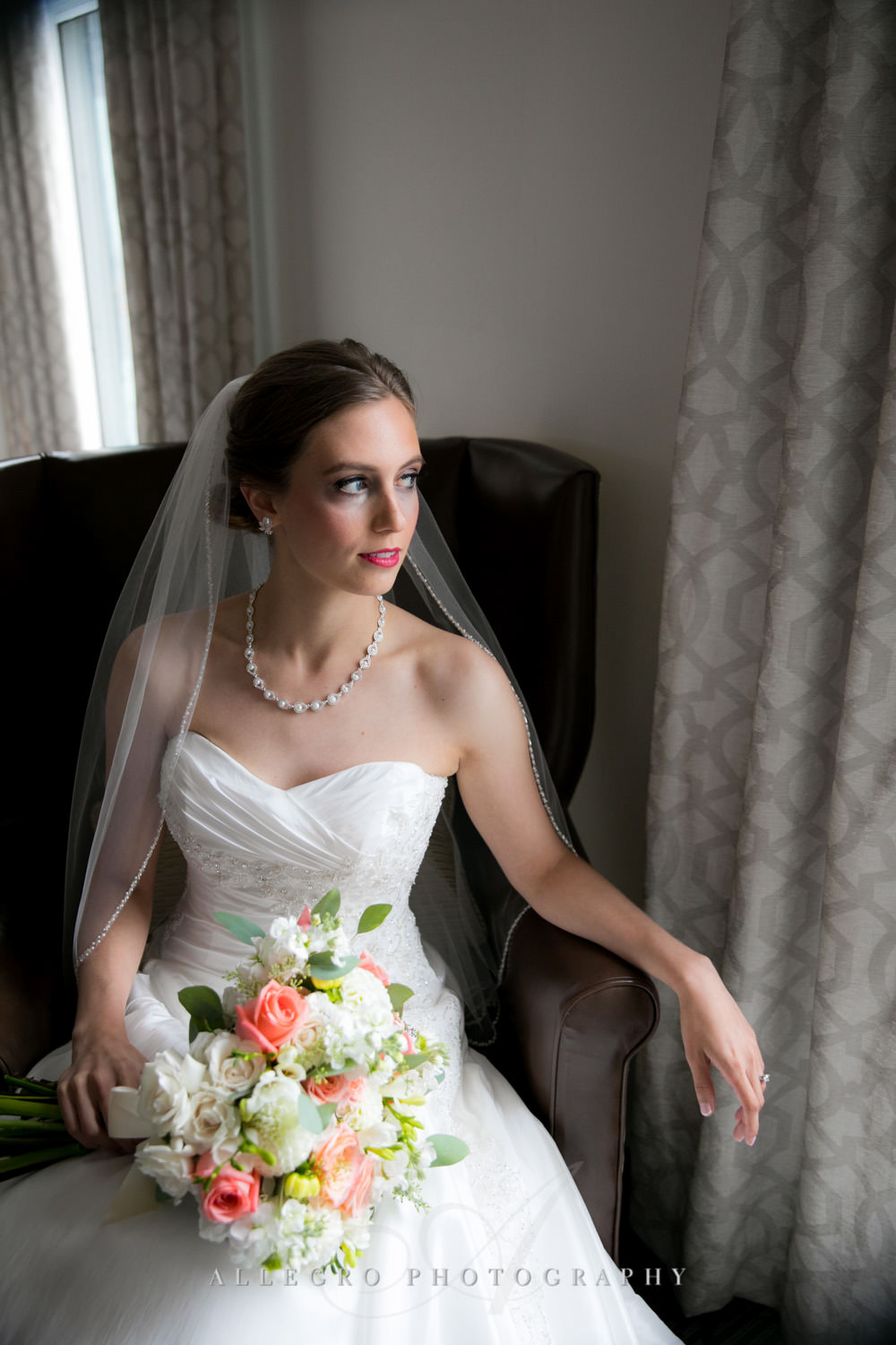bride looks out window as she is ready