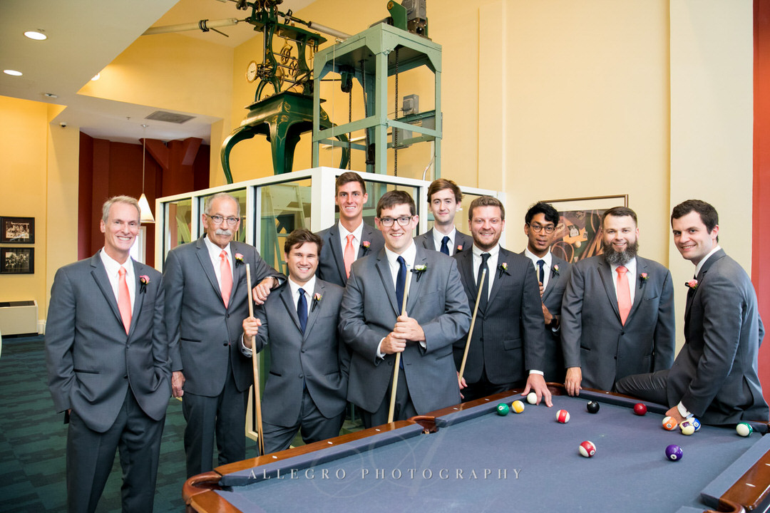 groom and groomsmen smile after playing a round of pool