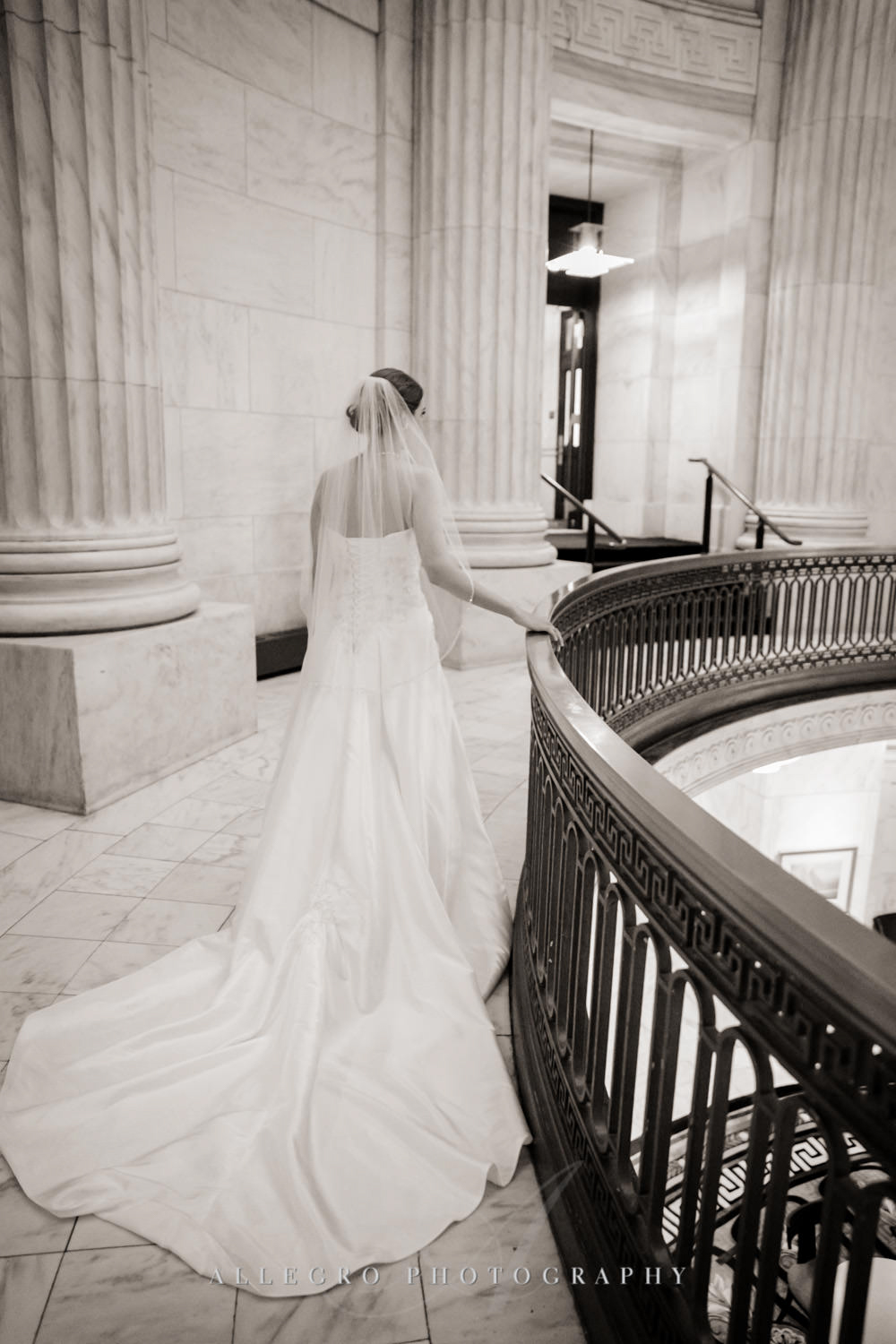 bride makes her way to groom for first look in black and white