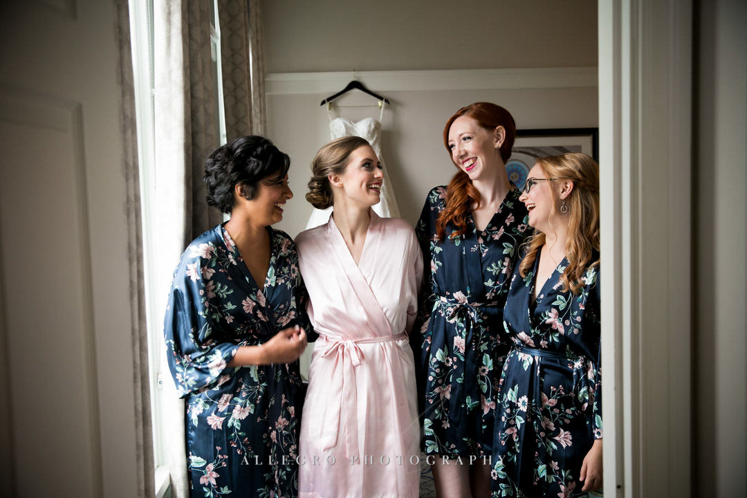 bride smiles with her bridesmaids