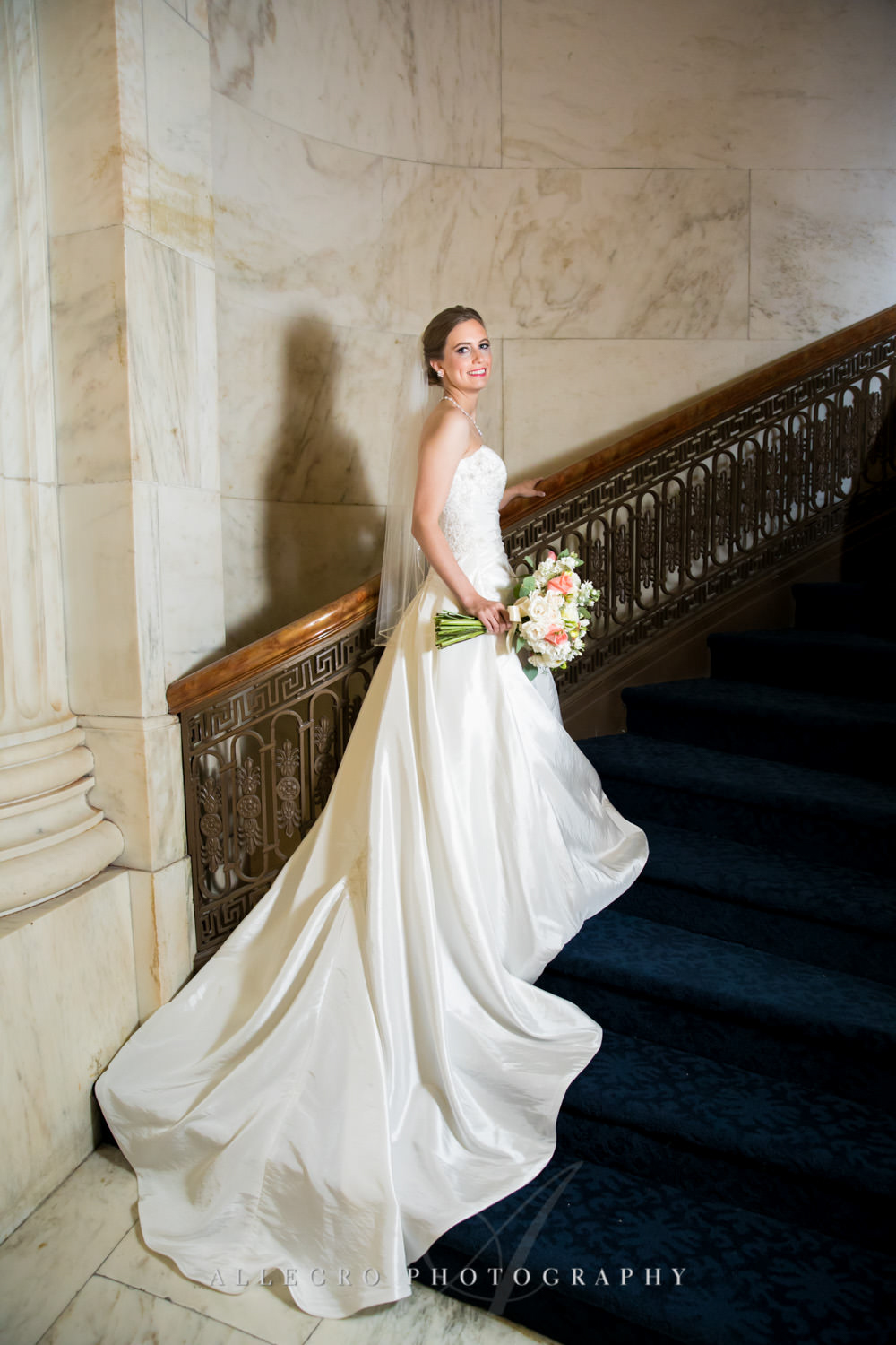bride poses on stairs in custom house