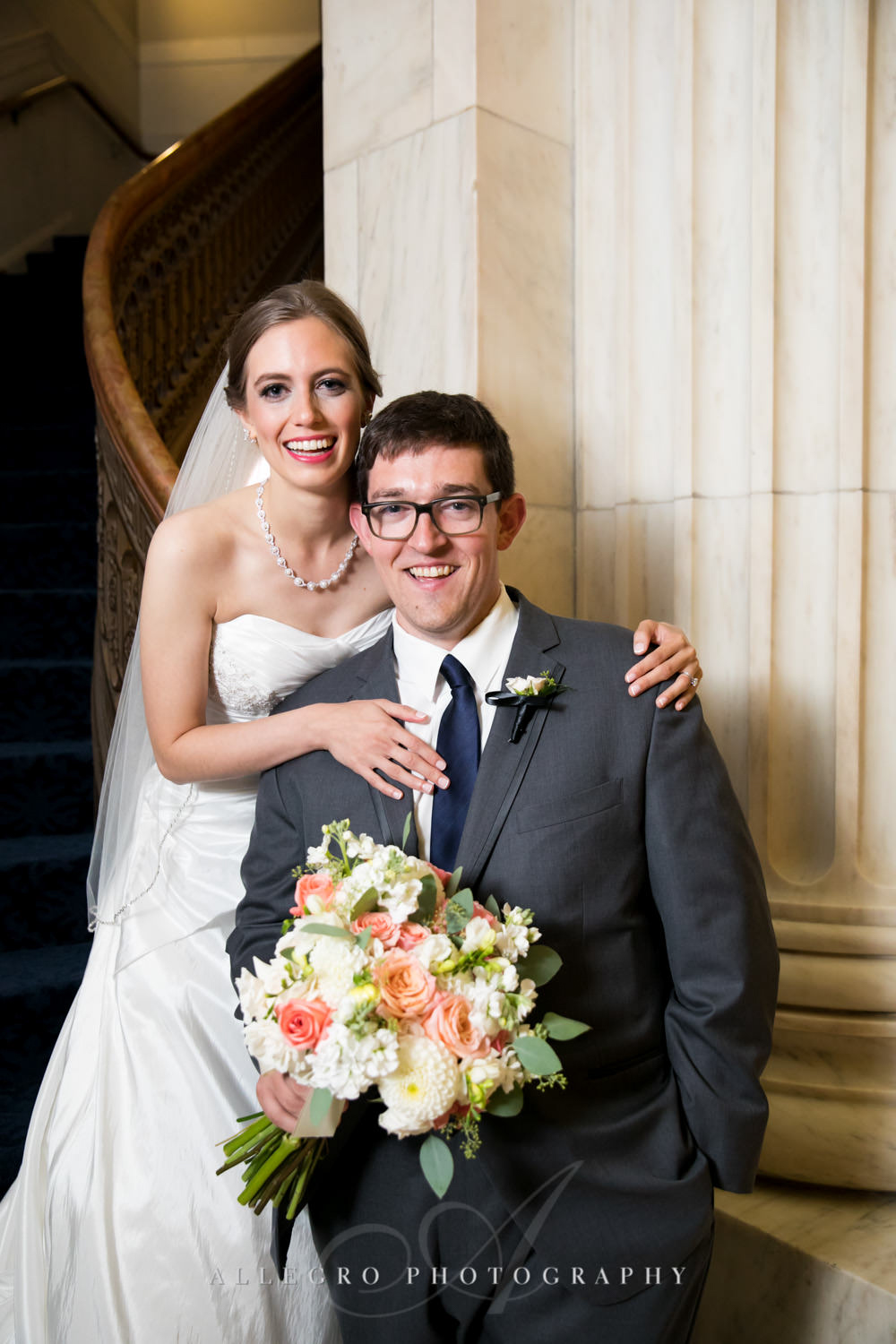 bride and groom pose together in custom house