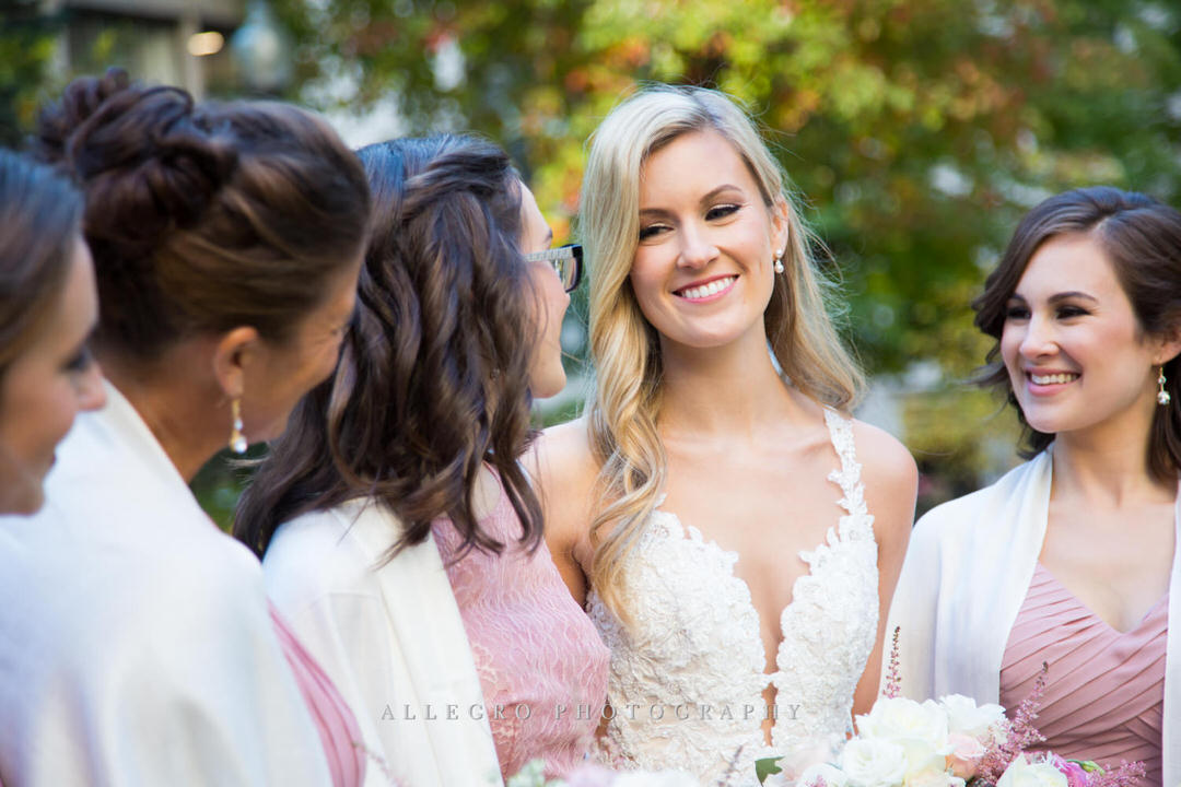 bride looking at her bridesmaids