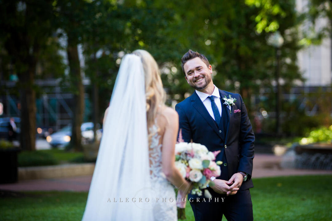 Grooms first look at bride in post office square
