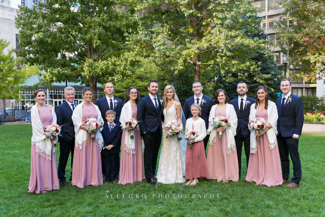 bride and groom with their bridesmaids and groomsmen in post office square