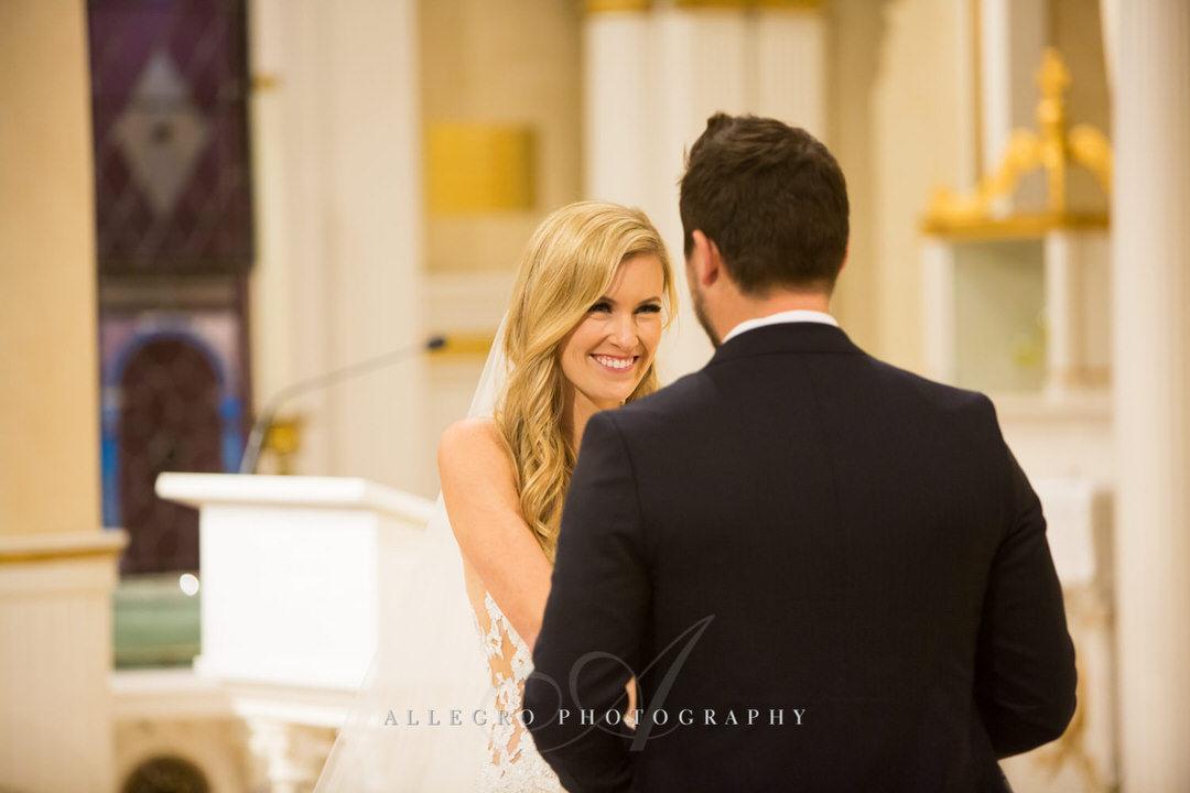 bride smiles at groom at altar