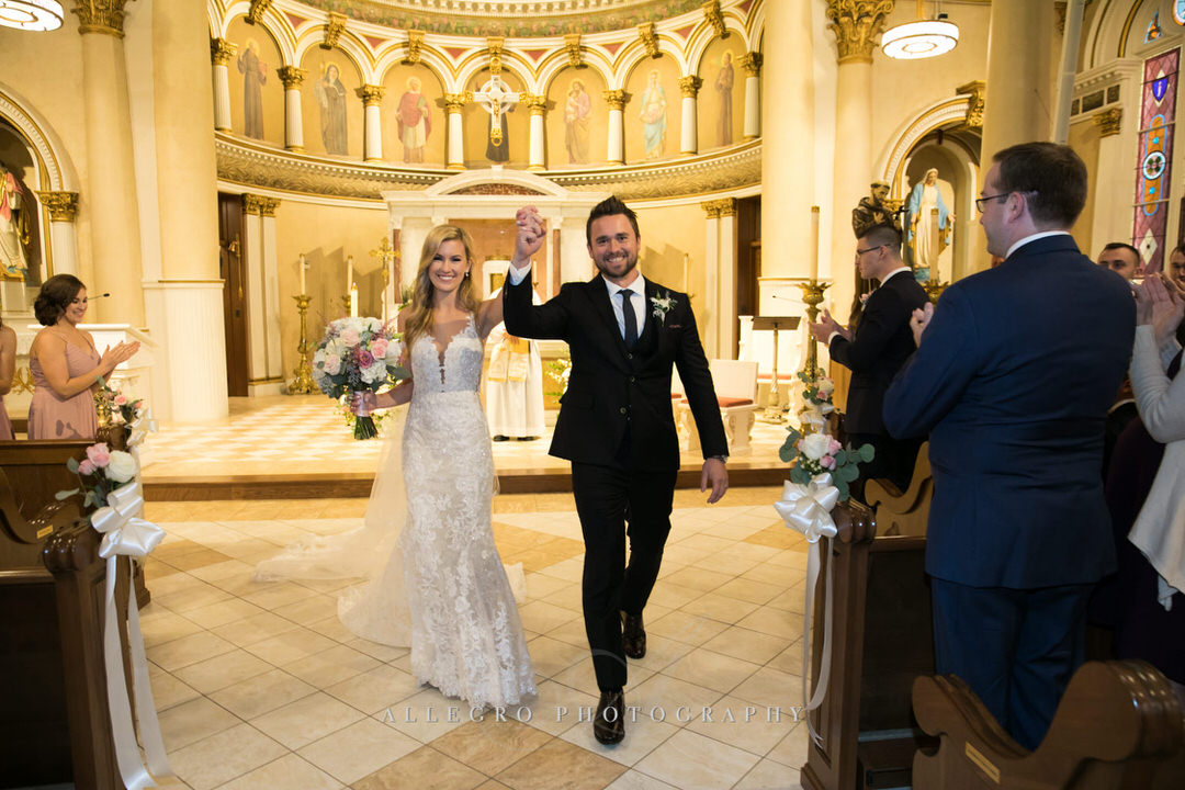 bride and groom walking out of church as husband and wife