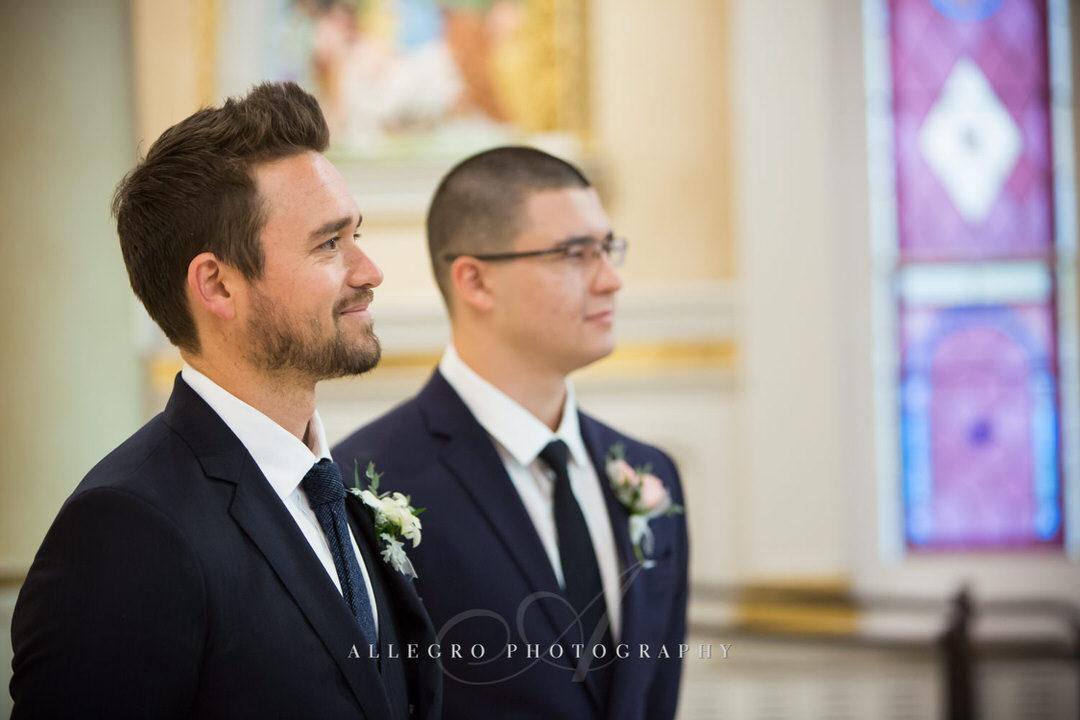 groom and groomsmen watching for bride