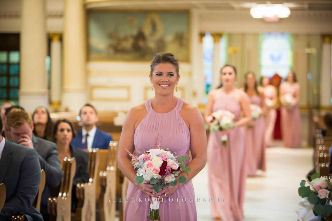 bridesmaids walking down the aisle