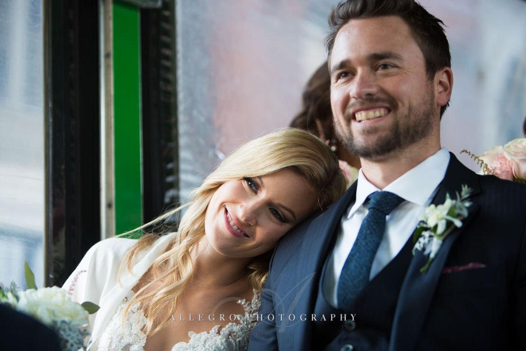 smiling bride rests head on smiling groom