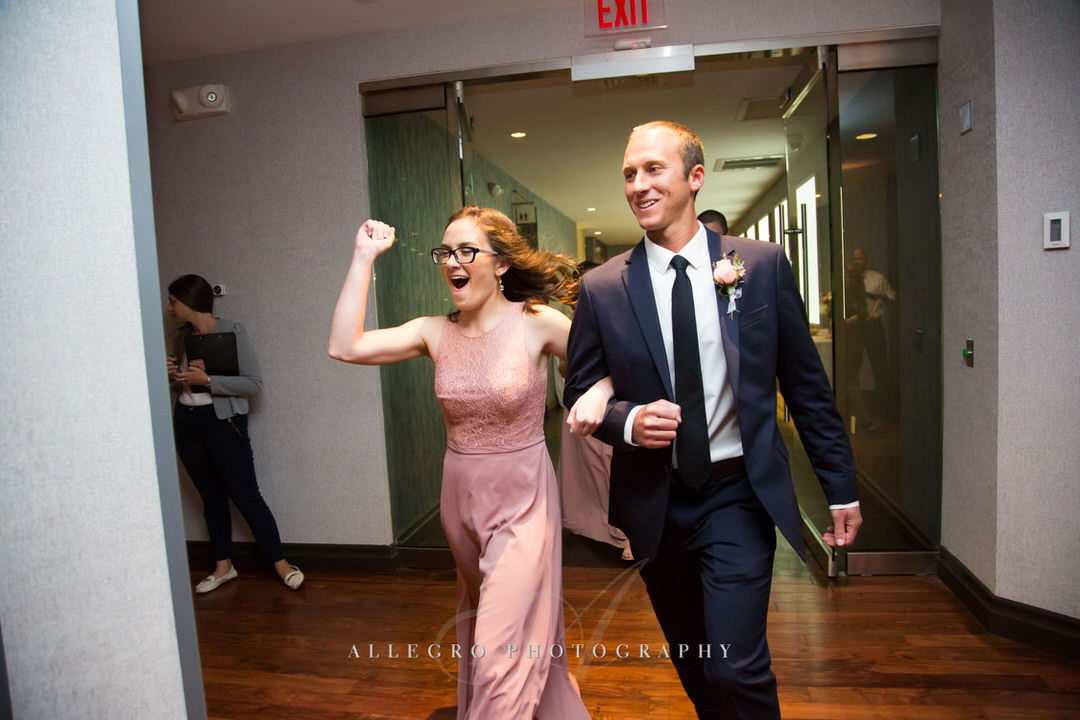 bridesmaid and groomsmen make a bug entrance