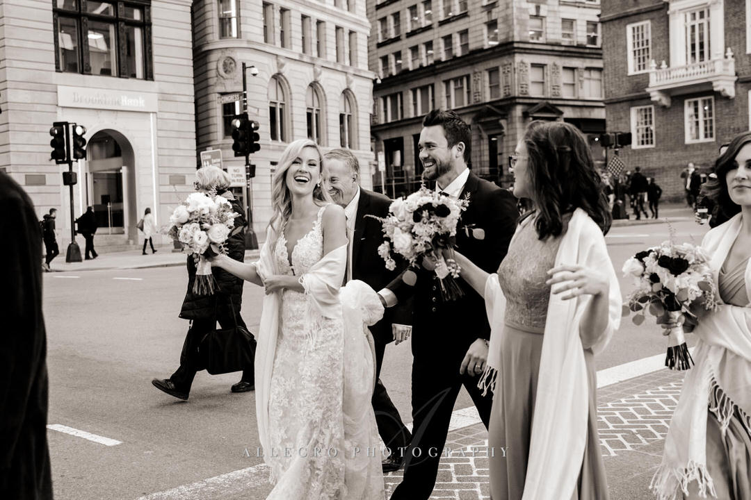 bride and groom walking through boston