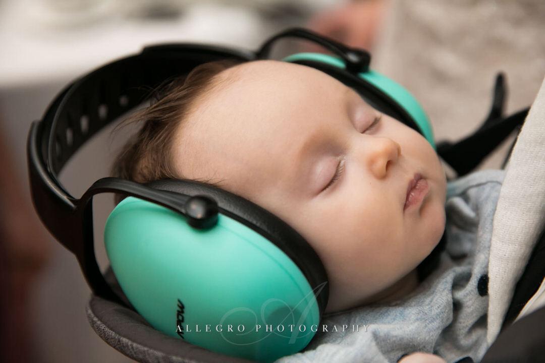 baby wears earmuffs